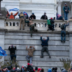 Rioters scale the Capitol on January 6